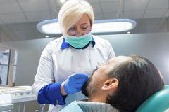 Dental doctor at work. royalty free stock photography