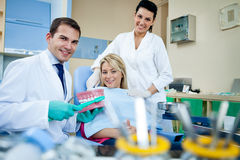 Dental education. Dentist demonstrate tooth brush in dental practice office  - dental education concept Stock Images