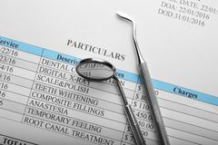 Dental equipment on papers. Close up Royalty Free Stock Image