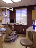 Dental Exam Room - Empty patient chair and light Royalty Free Stock Photos