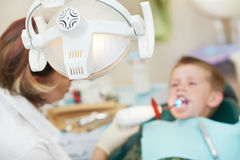 Dental filing of child tooth by ultraviolet light Royalty Free Stock Photos