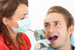 Dental filling. The dentist is filling the patient's tooth Stock Photo