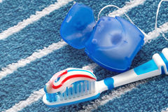 Dental floss and a blue toothbrush Stock Photography