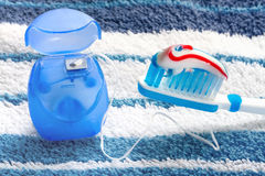 Dental floss and a blue toothbrush Stock Photo