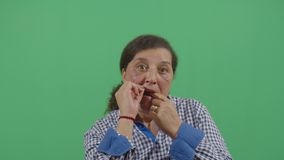 Dental Floss Cleaning By A Woman. In Ecuador stock footage