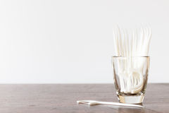 Dental floss in glass on wooden background Royalty Free Stock Photo