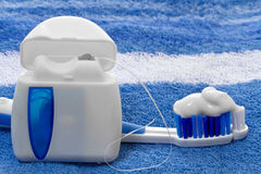Dental floss and toothbrush Stock Photo