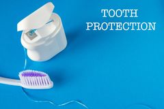 Dental floss and toothbrush stock image