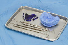 Dental gypsum models and dental brace (Retainer) Royalty Free Stock Photography