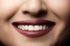 Dental. Happy smile with red lips make-up, white healthy teeth Royalty Free Stock Photography