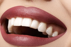 Dental. Happy smile with red lips make-up, white healthy teeth Stock Photos