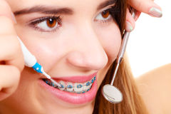 Woman with braces having dentist appointment. Dental health care, stomatology concept. Woman with braces having dentist appointment, looking at teeth with small Stock Images