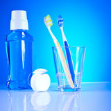 Dental health care toothbrushes. Dental health care symbols on the blue background Royalty Free Stock Image