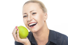 Dental Health: Portrait of Pretty and Happy Blond Female Biting Stock Photo