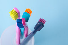 Dental hygiene. Four toothbrushes - dental hygiene. Top view, selective focused on top of right toothbrush, blue background Stock Photo