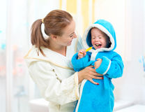 Dental hygiene in bathroom. Mother and child cleaning teeth. Royalty Free Stock Photos
