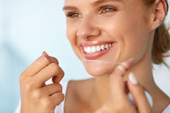 Dental Hygiene. Beautiful Woman Flossing Healthy White Teeth. Dental Hygiene. Closeup Of Beautiful Happy Smiling Woman With Beauty Face And Perfect Smile Stock Image