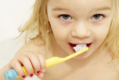 Dental hygiene. Close up of little girl brushing her teeth Royalty Free Stock Photography