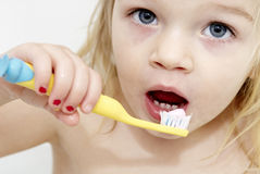 Dental hygiene. Close up of little girl brushing her teeth Stock Photos