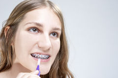 Dental Hygiene Concepts. Caucasian Teenage Girl Using Bristle Te Stock Images