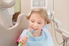 Dental hygiene. Dentist demonstrating tooth brushing Stock Photos