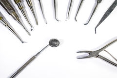 Dental Instruments arranged on white table. Dental Instruments arranged on white table - isolated Royalty Free Stock Image