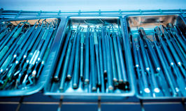 Dental instruments kit in the trays background Royalty Free Stock Photography