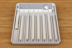 Dental instruments in metallic tray on the wooden table. 3D rend. Dental instruments in metallic tray on the wooden table. 3D Royalty Free Stock Photography