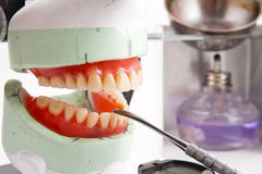 Dental lab articulator and equipments for denture. Dental lab articulator with equipments for denture royalty free stock photos