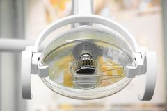 The Dental light a illuminate. Dental light to illuminate the patient during operation, close up nobody stock photos