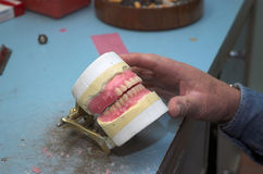 Dental Mac. Hands of a Dental Mechanic at work stock photography
