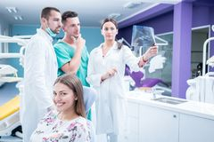 Dental medical team examining and working on young ¸female pati stock image