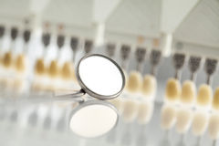 Dental mirror and color shades Royalty Free Stock Images