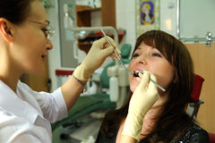 In the dental office. Patient in a chair at the dentist Royalty Free Stock Photography