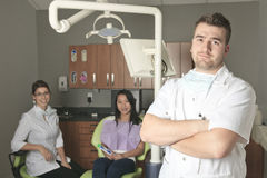 A dental office with employee and client Stock Photo