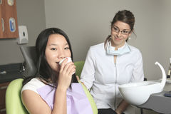 A dental office with employee and client Royalty Free Stock Image