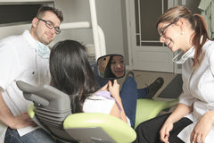 A dental office with employee and client Stock Photography
