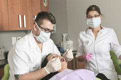 A dental office with employee and client Stock Photos