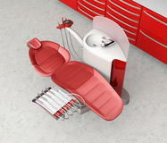 Dental office interior with metallic red unit equipment and cabinet Royalty Free Stock Photo