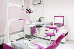 Dental practice with chair Stock Images