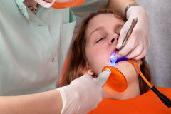 Dental procedure, led laser Royalty Free Stock Photos