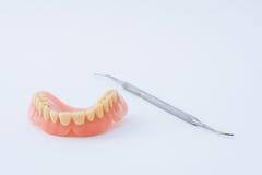 Dental prosthesis and instrumental. Dental prosthesis and specific instrumental stock photos