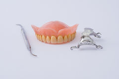 Dental prosthesis and instrumental. With white background Stock Images