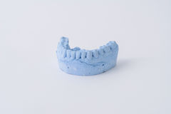 Dental prosthesis mold. Dental prosthesis blue mold with white background Stock Images