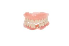 Dental prosthesis on white background Royalty Free Stock Images