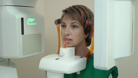 Dental X-Ray Scanner and Patient. Dental X-Ray Scanner and woman Patient stock footage