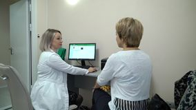 Dental X-Ray Scanner and Patient. Dental X-Ray Scanner and woman Patient consultation stock video footage
