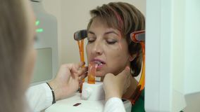 Dental X-Ray Scanner and Patient. Dental X-Ray Scanner and woman Patient stock video footage