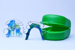 Dental retainer closeup. Dental retainer close up on light blue background Stock Photos