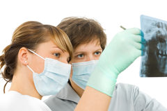 Dental Rx examine. Two sweet young doctor examine the dental Rx Stock Photo